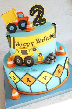 Construction themed 2nd birthday cake inspired by the party decor.