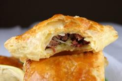 Corned beef and cabbage turnovers -- St. Patrick's day food:  2 Tablespoons canola oil  1 medium sweet onion, finely chopped (about 1 cup)  4 cups coleslaw mix (12 ounces of shredded cabbage & carrot)  1/2 pound cooked corned beef, chopped finely