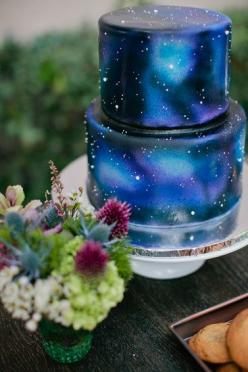 How dreamy is this space wedding cake? I would have no way to DIY this, though, and so probably would be best off leaving this to a professional... would one or two red roses and the silhouette cake topper I like be too much?: Galaxies, Galaxy Cake, Weddi