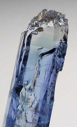 Jeremejevite   Erongo Mountains, Namibia.  Glassy single crystal of relatively large size with excellent blue color throughout most of the crystal with a light blue to clear zone at the very tip. There is natural etching of the termination and some prism