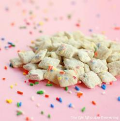 New take on the puppy chow! Cake Batter Muddy Buddies: Melt 10 oz. vanilla almond bark, thin with vegetable oil if needed.  Pour over 5 cups of Rice Chex stirring thoroughly.  Shake on some sprinkles.  Mix 3/4 c. yellow cake batter an 1/4 c. powdered suga