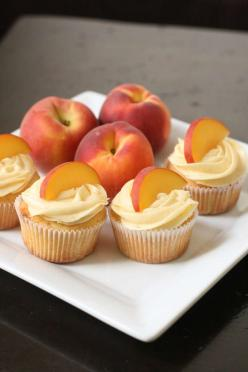 Peach cupcakes with peach cream cheese frosting. I need to make these before summer is gone.: Cup Cakes, Cuppycake, Sweet, Peach Cupcakes, Food, Yummy Cupcakes, Peach Cream Cheeses, Peaches, Cream Cheese Frosting
