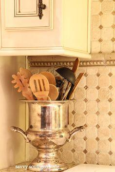silver urn to display wooden spoons