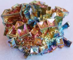 Bismuth. (Need to learn about this, really pretty.) Element Bi  Atomic number 83  but there is A LOT of information on this. Many forms of it, one is used in making Pepto B. Some forms with lead and arsenic.  Chemists and Physicists understand it, it'