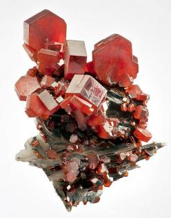 Flashy specimen featuring thick reddish-orange Vanadinite crystals on Barite. From the Mibladen Mine, Mibladene, Midelt, Meknès-Tafilalet Region, Morocco. Measures 4.2 cm by 3.3 cm by 2.9 cm in total size. Ex. Martin Zinn Mineral Collection: Orange, Cryst