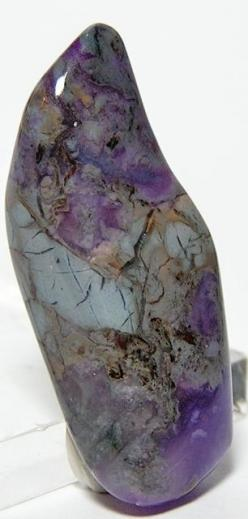 Purple Sugilite - a good pain reliever, the manganese in Sugilite clears headaches & discomfort on all levels. It treats epilepsy & motor disturbances & brings the nerves & brain into alignment. Light coloured Sugilite purifies lymph &