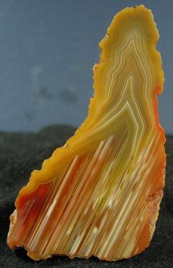 Queensland agate. Agate is the banded form of the mineral Chalcedony, which is a microcrystalline variety of Quartz. Agate is the most varied and popular type of Chalcedony, having many varieties on its own. Although the pattern on every Agate is unique,