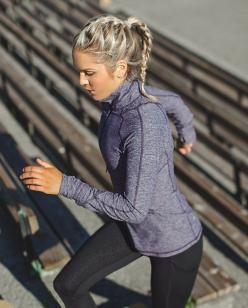 Race Your Pace 1/2 Zip | We hit the ground running year round so we made this half-zip to move with us. The cozy fabric is soft against our skin as a base layer when it's chilly, and perfect over a tank when temperatures are on the rise. Race you to t