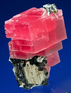 Tremendous specimen of Rhodochrosite atop a large Pyrite with Tetrahedrite and Quartz!  From Collector's Pocket, 2nd Crosscut, Sweet Home Mine, Alma, Colorado.  Measures 5.6 cm by 4 cm by 3.4 cm in total size.  Ex. Bryan Lees Personal Collection  Pric