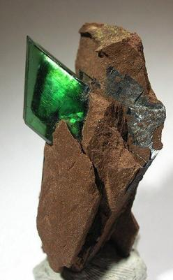 Vivianite... Vivianite is a well-known phosphate mineral, forming in highly aesthetic sharply colored crystals. Vivianite is named in honor of John Henry Vivian, an English mineralogist and mine owner who first discovered this mineral in Cornwall.Chemical