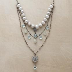 "Sundance. Adriana Goddard's multi-strand pendant necklace strikes a regal balance between Victorian grandeur and modern sensibility. Handcrafted in the USA of freshwater pearls, blue quartz, aquamarine and sterling silver. Lobster clasp. 18 to 21""L.:"