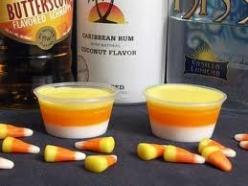 Candy corn shots - the link goes nowhere but from the looks of it you layer - Malibu coconut rum, butterscotch shnapps, and Kiss vanilla liquor - not sure exactly how all 3 colours come about though.: Holiday, Jello Shots, Candy Corn, Corn Jello, Candycor