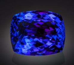 LARGE TANZANITE - 61.43 CT.  Merelani Hills, Umba Valley, Lelatema Mountains, Arusha Region, Tanzania   Luscious is a term that comes to mind when looking at this Tanzanite. Other superlatives might be big or huge. At 61.43 carats this is a very impressiv