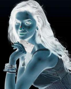 This seriously works!                                                 1. Stare at the red dot on the girl's nose for 30 seconds                                                2. Turn your eyes towards the wall/roof or somewhere else on a plain surface  3.