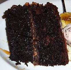 CHOCOLATE TRUFFLE LAYER CAKE      2 Squares (2 ounces) semi sweet chocolate    1 Cup sugar    2 Teaspoon cornstarch    3 Egg yolks    1 ¼ Cup milk    2 Cups sifted flour    1 Teaspoon soda    ½ Teaspoon salt    ½ Cup butter    1 Cup firmly packed brown su