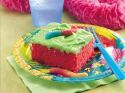 Sour Patch Kids Cake-using Betty Crocker's Super Sour Cake Recipe  (Cake:  cake mix, unsweetened Kool-aid, and Limeaid) (Icing:  Butter, Powdered Sugar, Limeaid, Unsweetened Koolaid)  I'll add some sour patch kids to the top of it so people have s
