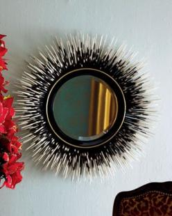 When I first saw this mirror of porcupine quills I went 'ewww', but its not like they had to kill the porcupine for the quills, so maybe not 'ewww'.  Then I saw a DIY mirror made with painted bamboo sticks - great idea for those of us with