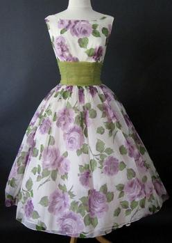 1950's chiffon party cocktail dress with large purple and lavender roses.    Printed chiffon over white satin and a built in crinoline. Wide green over yellow chiffon cummerbund creates a modified shelf bust construction.: 1950S Chiffon, Party Dresses