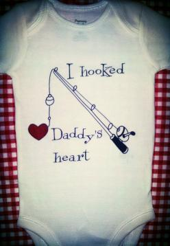 I HOOKED DADDY'S HEART Cute Baby Onesie , Just in time for Father's Day. Sweet Baby Onesie ,  Fathers Day Gift  , Fishing Onesie . Under 25: Cute Baby Outfits For Girls, Baby Tshirt Ideas, Father'S Day Gifts, Daddy S Heart, Baby Clothes, Cute