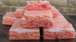 These strawberry brownies are insanely delicious. If you've never tried them, you absolutely must. They taste like a bar cookie version of strawberry cake but easier to make, transport, and eat (no utensils required). This is one of the most repinned