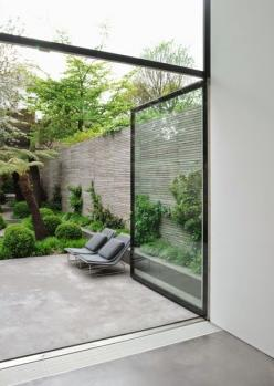 I'd love to have kitchen wall entirely in glass like here and fell like outdoor is indoor. Abigail Ahern inspired look: Interior, Glass Doors, Concrete Patio, Indoor Outdoor, Garden