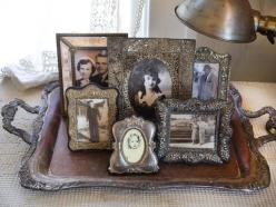 Antiquated Style  Set aside a small area in a room that you can dedicate to an antique arrangement. In a suite full of modernly chic style, tarnished silver picture frames like this boost its entire charm.: Photo Display, Idea, Shabby Chic, Frames, Vintag