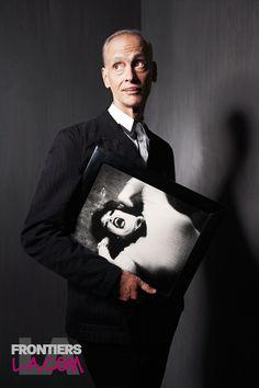 John Waters with a picture of Divine