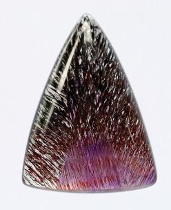 Melody Stone by schwigorphotos, via Flickr  This striking gemstone is a natural crystal from the State of Espirito Santo (Holy Spirit), in Brazil. It is known as Sacred Seven, Super Seven or Melody Stone because it is a mix of seven minerals, amethyst, cl