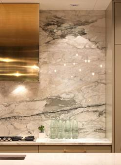 brass range hood and marble wall: Kitchens, Interior Design, Marbles, Kitchen Design