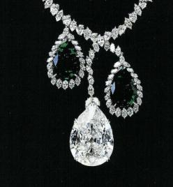In Paris -Mrs. McLean was able to buy the wedding present which her father had told her to get. Pierre Cartier showed her the Star of the East, a fine 94.80-carat pear-shaped diamond, mounted on a chain below a hexagonal emerald of 34 carats and a pearl o