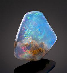 Things like this piece of Galaxy opal are proof of God for me. I don't think it's a coincidence that this thing formed on the earth, yet looks just like the galaxy above the earth.: Crystals, Gemstones, Stuff, Against Light, Rocks, Opals, Minerals