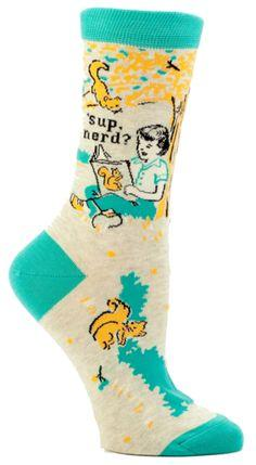 "You KNOW this person. She needs these socks.  Tan, orange, and turquoise crew length sock with a girl reading and some squirrels saying: ""'sup nerd?""  Fits women's shoe size 5-10."