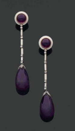 CARTIER. 1920s. RARE PAIR long earrings ending in a pear cabochon amethyst Pavé pellet rose cut diamonds. They are retained by a chain link white enamel stick to all sides, baguette diamonds and polished. The round ear design wearing a amethyst cabochon i