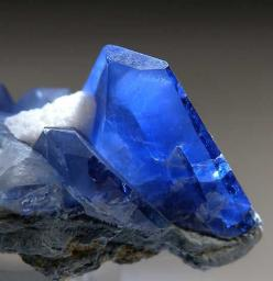 Benitoite crystals on matrix. a rare blue barium titanium silicate mineral, found in hydrothermally altered serpentinite. BaTiSi3O9: Stones Gems Rocks Crystals Etc, Gemstones, Gems Rocks Stones Crystals, Rare Blue, Benitoite Crystals, Minerals Rocks Gems,