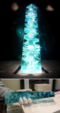 "Dom Pedro, the World's Biggest Aquamarine Gem.  The obelisk-shaped, blue-green gem, which was designed by famed German gem cutter Bernd Munsteiner, known as the ""father of the fantasy cut,"" stands 14 inches (35.5 centimeters) tall and weighs 1"