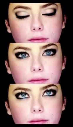 Eyeliner. Notice how there's a hint of blue on her lower lids...and she has blue eyes. Traditionally you go opposite in eye makeup colors (blue eyes get neutral colors, brown gets jewel tones), but I have blue eyes and do this on occasion. It really m