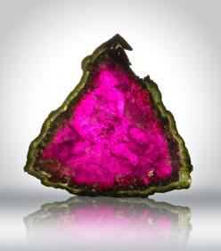 Watermelon tourmaline. Tourmaline is a crystal boron silicate mineral compounded with elements such as aluminium, iron, magnesium, sodium, lithium, or potassium. Tourmaline is classified as a semi-precious stone and the gemstone comes in a wide variety of