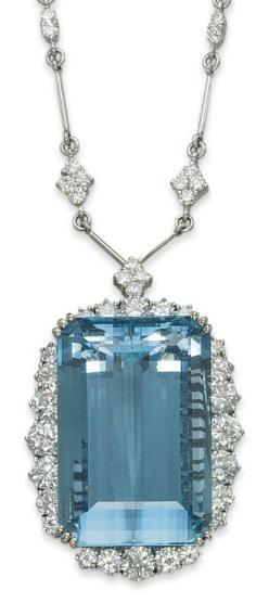 AN AQUAMARINE AND DIAMOND NECKLACE  The pendant centering upon a large rectangular-cut aquamarine within a graduated brilliant-cut diamond surround, to the diamond-set quatrefoil link chain, mounted in gold