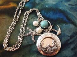 Mermaid, Turquoise, Anchor, and Starfish... Everything I love! WANT!  Mermaid Locket Necklace Silver Plated with Pearls and by agothshop, $17.00: Mermaid Locket Necklace, Plated Mermaid, Locket Necklaces, Mermaid Necklace, Mermaids, Necklace Silver, Charm