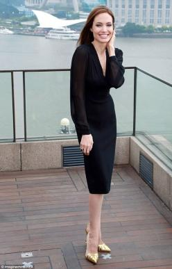 Best foot forward! Angelina Jolie let her custom Louboutins be the star of her outfit at the Maleficent photocall in Shanghai