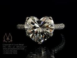 Heart shaped engagement ring by Leon Mege    Would just be fun for a guy to give the gal of his life for valentine's day or anniversary or just because he loves her that much.