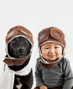 Jasper and Zoey as air pilots -- Photographer Grace Chon turns the camera on Jasper, her 10-month-old baby, and Zoey, her 7-year-old rescue mutt for a photo series that features the stylish pair decked out in an eccentric variety of matching headgear. (Mo
