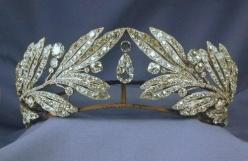 Laurel Leaf Tiara- Queen Sophia of Greece. I like the way this tiara is somehow opposite of the usual lines, which seem to flow from the center and down. Here each side reaches in, not meeting, but creating a vacuum for the large, pear shape diamonds to d