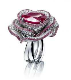 Exquisitly crafted open rose ring fashioned from pavé Burmese rubies and diamonds with a striking round-cut ruby center stone crafted from the Adler Haute Joaillerie Collection....