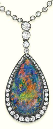 AN ANTIQUE OPAL AND DIAMOND PENDENT NECKLACE The pear-shaped black opal pendant mounted within a circular-cut diamond surround, suspended from a line of graduated collets to the similarly-set diamond collet neckchain, mounted in silver and gold, circa 189