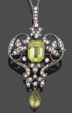 An early 20th century peridot and diamond brooch/pendant, circa 1900  The step-cut peridot within an openwork single-cut diamond surround of foliate and scroll design suspending a pear-shaped peridot drop, with diamond-set suspension loop to a fine trace-