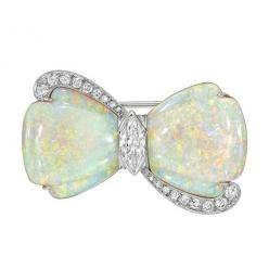 Carved opal and diamond bow pin, centering on a marquise-shaped diamond weighing approximately 0.71 carats (H-color/SI1 clarity) with eighteen full-cut and single-cut diamond accents weighing approximately 0.45 total carats, mounted in 18k and 14k white g