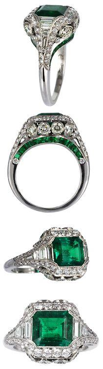 Elegant 2.26ct Colombian Emerald & Diamond Ring. Platinum custom made Colombian Emerald and diamond filagree ring with millgrain edges. Consisting of one bezel set emerald cut Emerald weighing approximately 2.26 carats and calibre cut emeralds along t