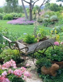 35 Cool Vintage-Looking Garden Pots | Shelterness: Garden Ideas, Wheelbarrow, Garden Art, Outdoor, Gardens, Garden