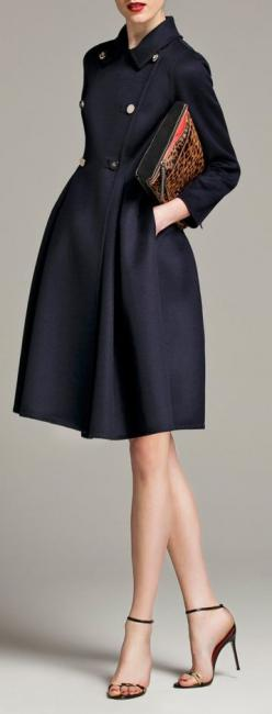 Carolina Herrera. Lovely coat. Feels like an image wed see from the 50s. Navy isnt a colour to stress over too much. It adapts well to skin tones and the other elements of the apparel. This could be fine on any of the 5 Autumn-influenced types of colourin